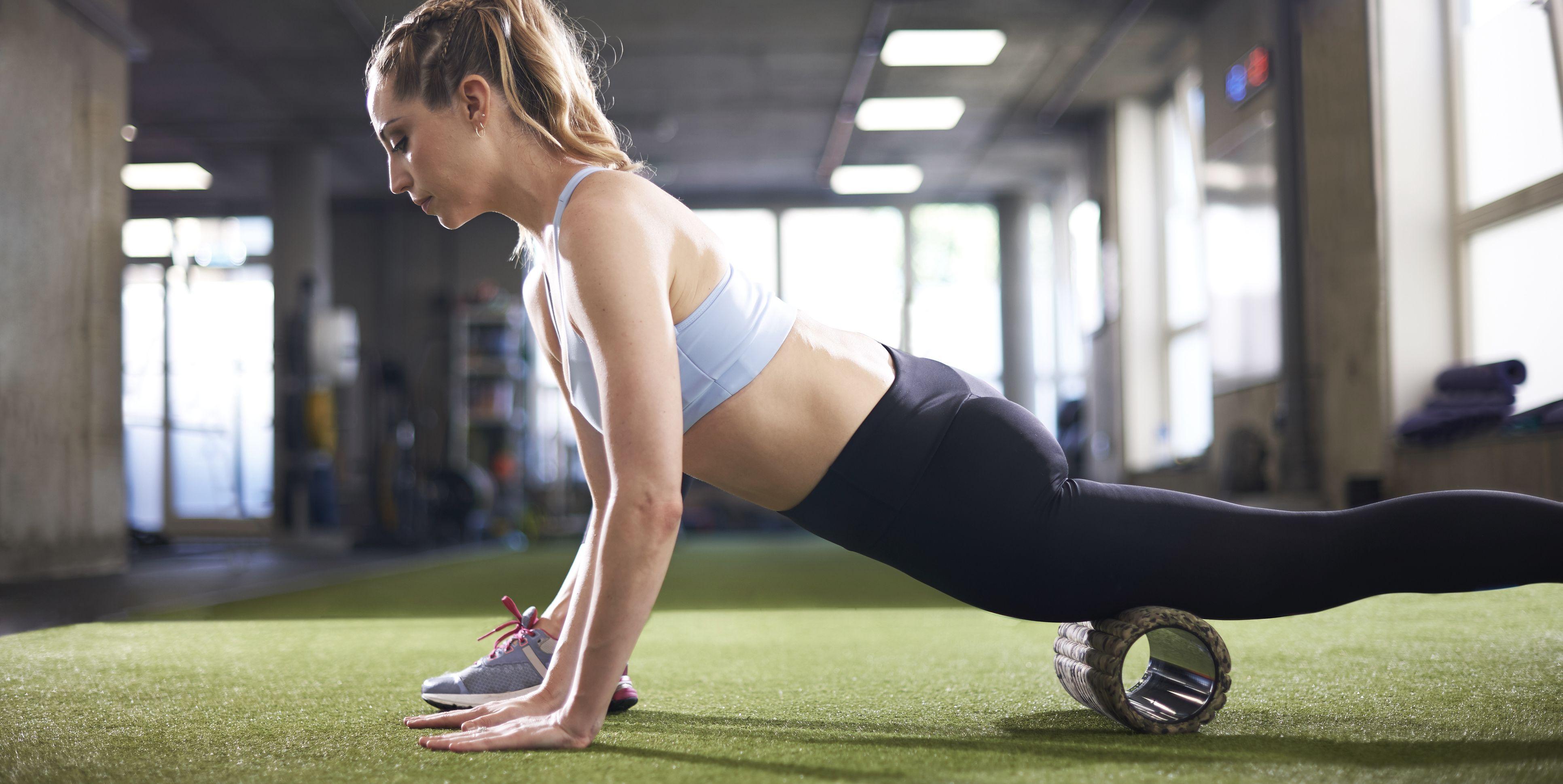 Woman using foam roller in gym