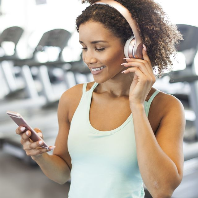 woman using smart phone at the gym