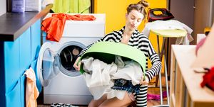 Woman washing clothes - how to keep your clothing from tangling in the tumble dryer