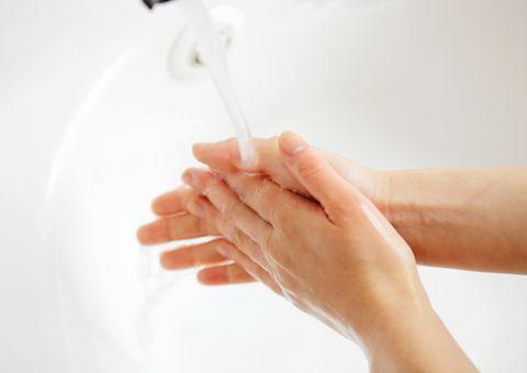 Woman washing hands,close up