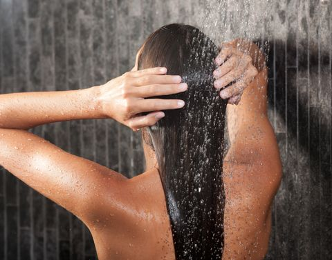 woman washing her hair under the shower