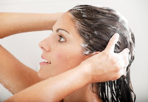 woman washing her hair with shampoo under the shower xxxl