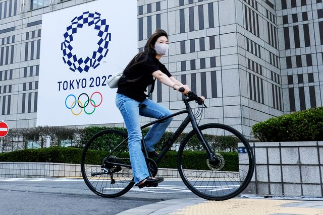 a woman wearing a face mask as a preventive measure against