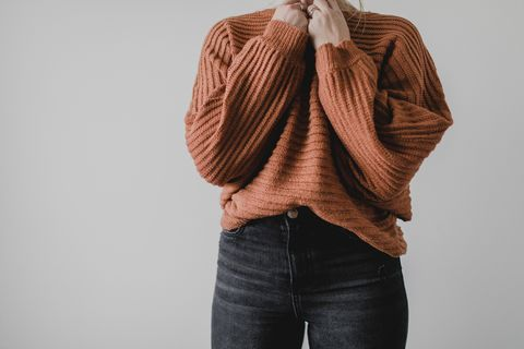 Woman wearing cozy sweater and jeans
