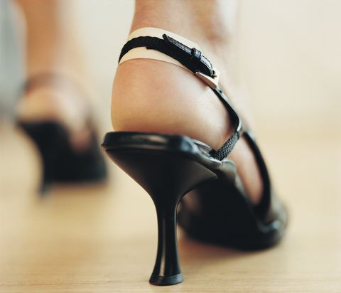 Woman Wearing High Heels on her Blistered Feet