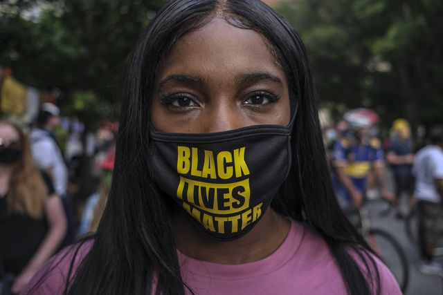 a woman wearing protective mask with black lives matter