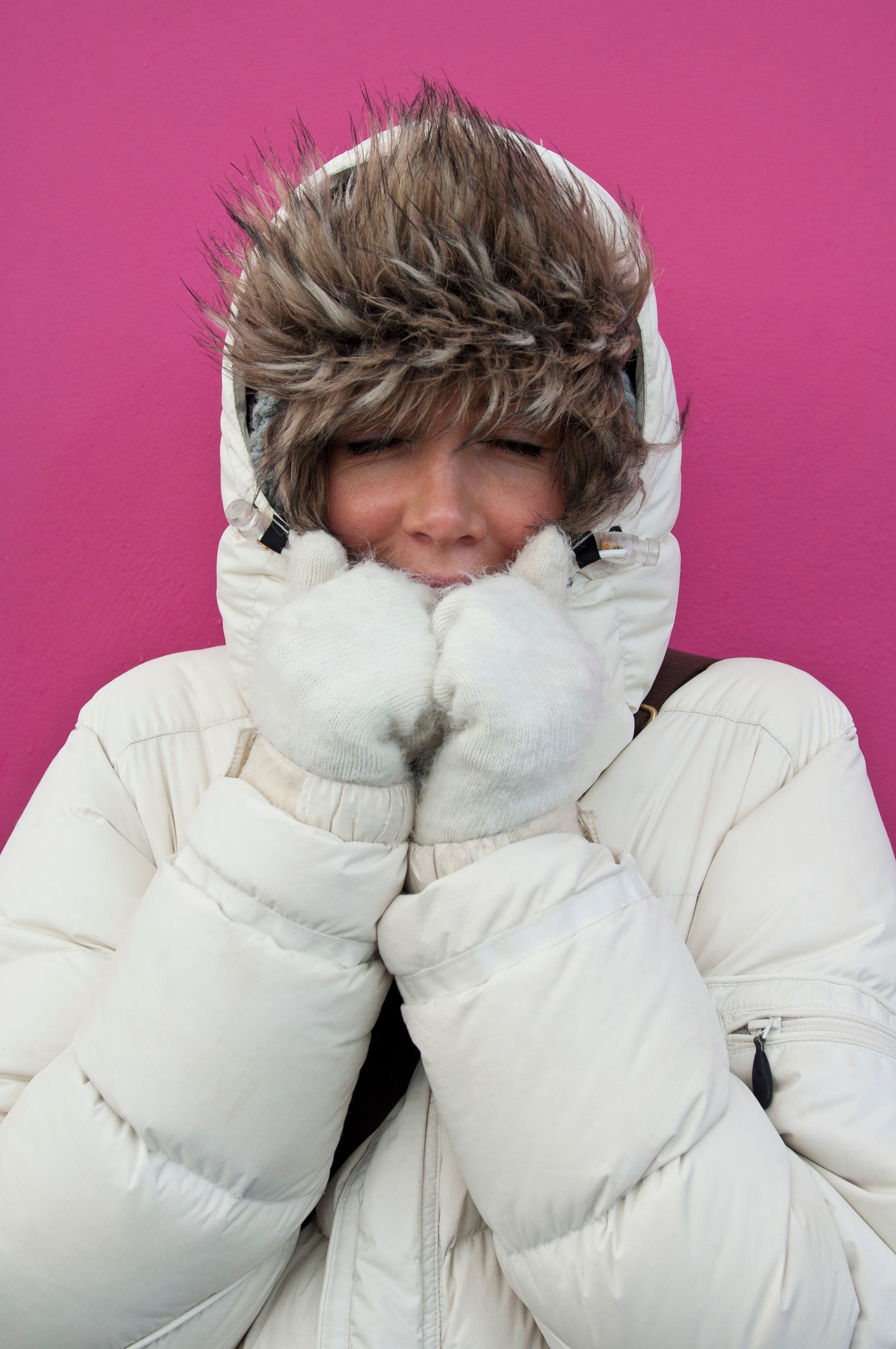 Woman wearing puffer jacket with hood