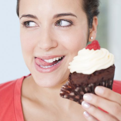 Woman with a cup cake