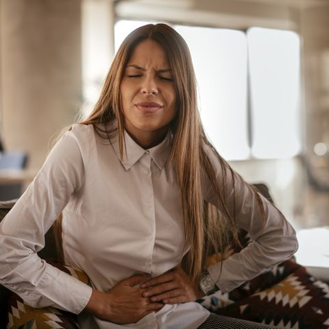 Woman with a stomach ache