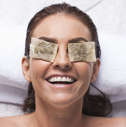 woman with tea bags on eyes