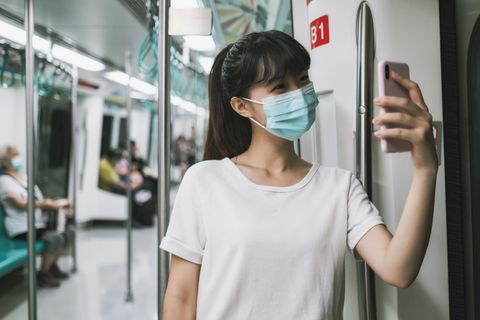 woman with mask in metro