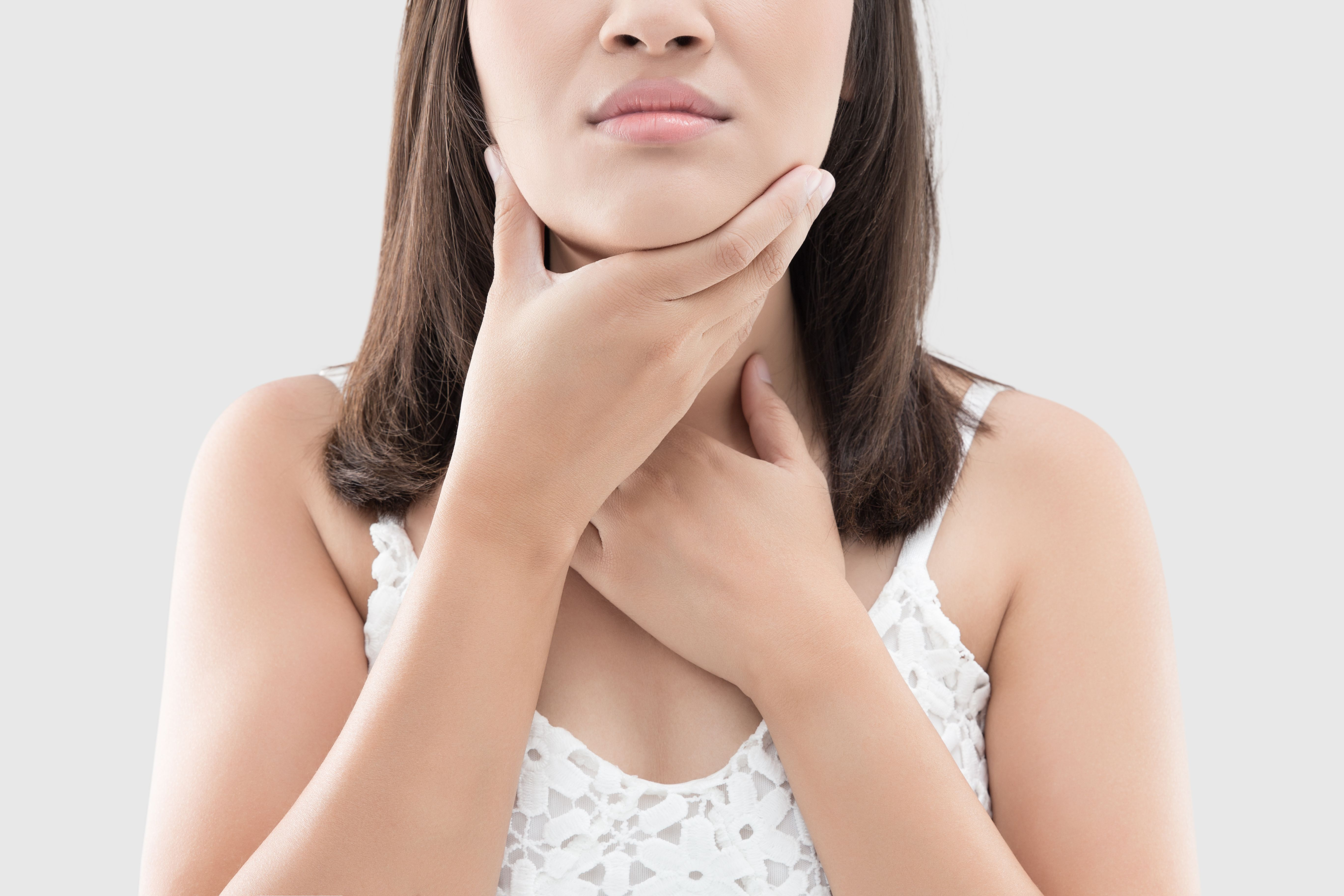 Woman With Throat Inflammation Against White Background