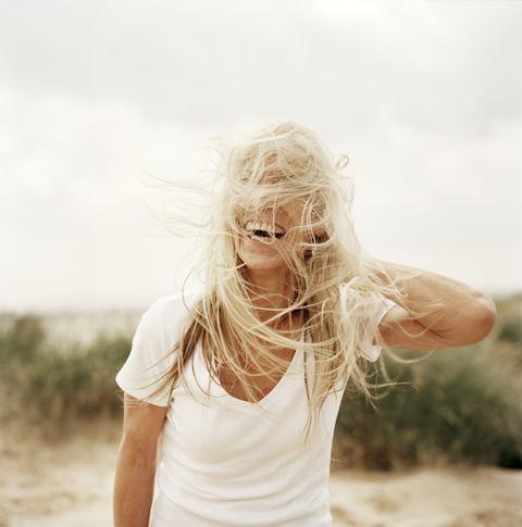 woman with windswept hair on beach
