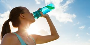 Woman working out drinking water