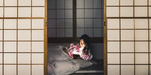 Woman working with tablet computer in a traditional ryokan
