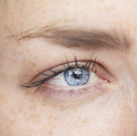 woman's blue eye, close up
