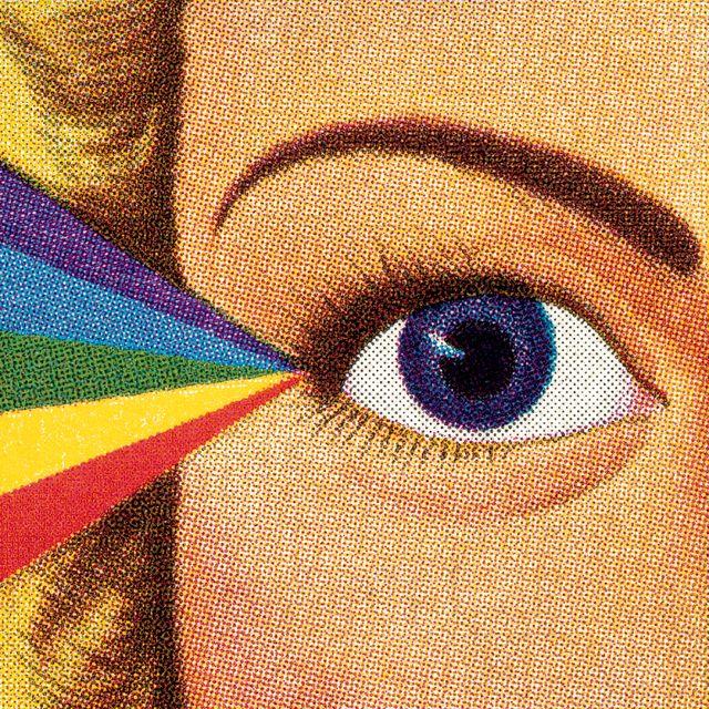 woman's eye and rainbow