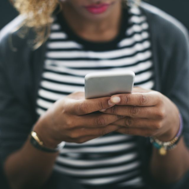 Woman's hands holding smartphone
