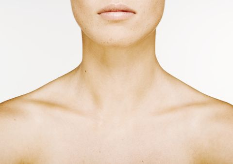 woman's lower face, neck and bare upper chest