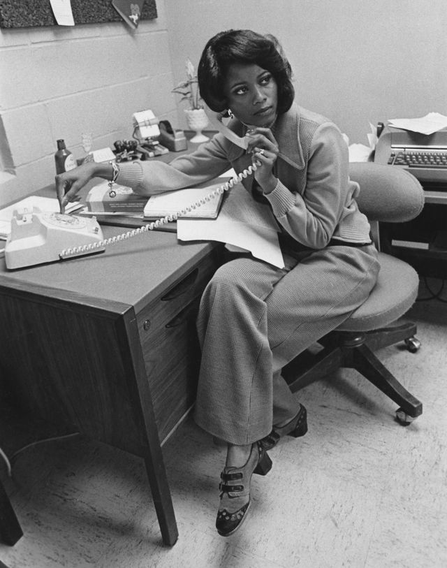 an african american office worker takes a phone call, usa, circa 1975 photo by fpgarchive photosgetty images