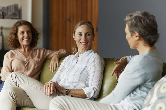 women conversing in living room