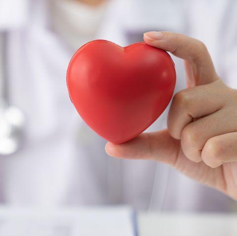 Women doctor holding heart,heart disease,Heart disease,Heart disease center