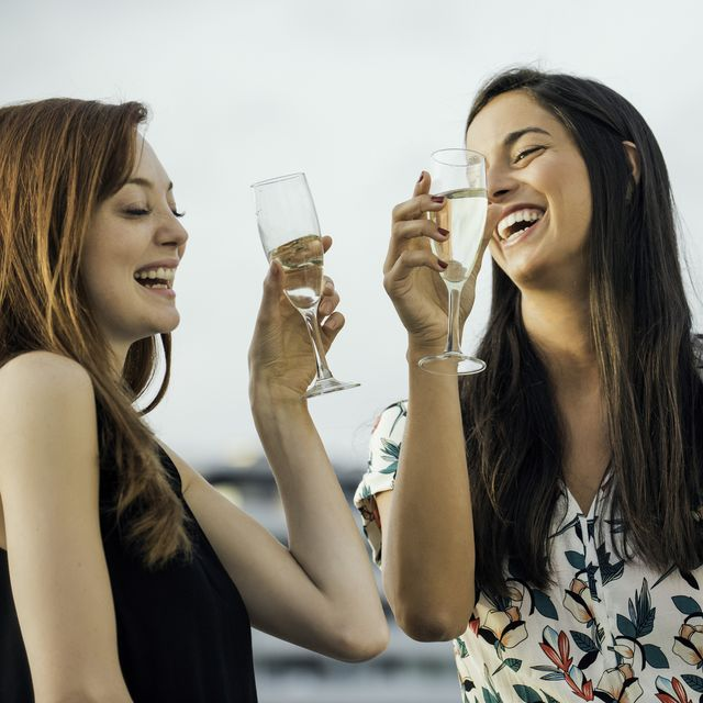 women drinking champagne outdoors