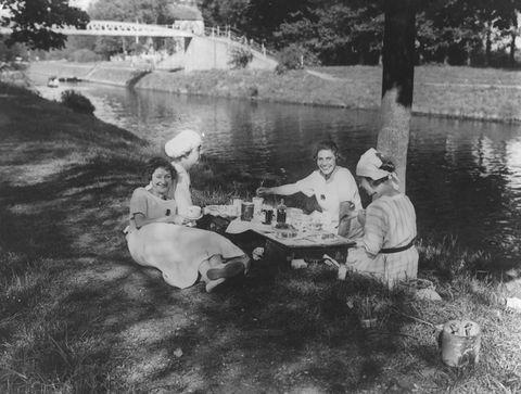 vintage photos   a group of friends riverside picnic