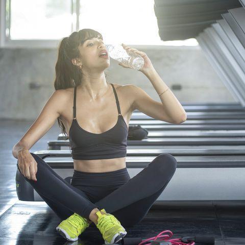 women exercising, drinking water
