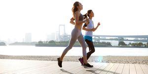 Women getting fit taking run afterwork in Tokyo