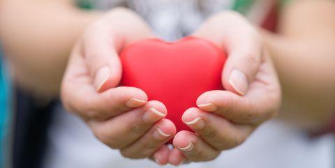 Women hand holding heart, heart disease concept