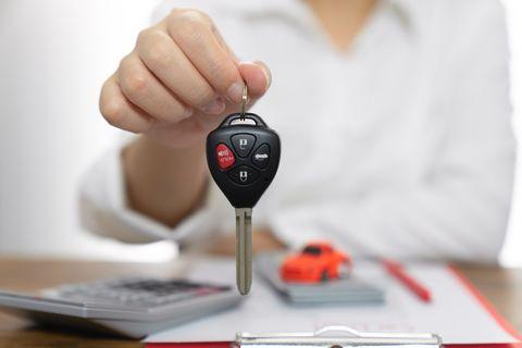 Women holding car keys,Sell cars,Car trading,Car insurance,Car insurance concept