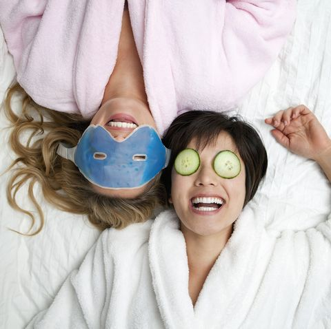 winter date ideas - Women in bathrobes wearing eye masks