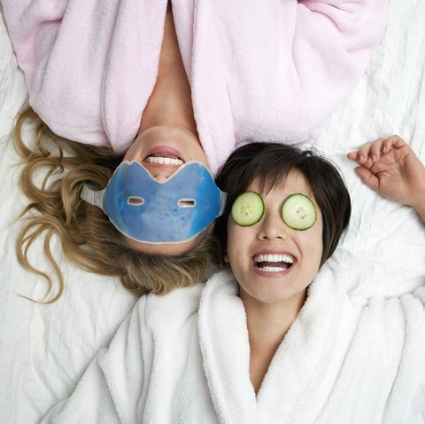 staycation ideas - Women in bathrobes wearing eye masks