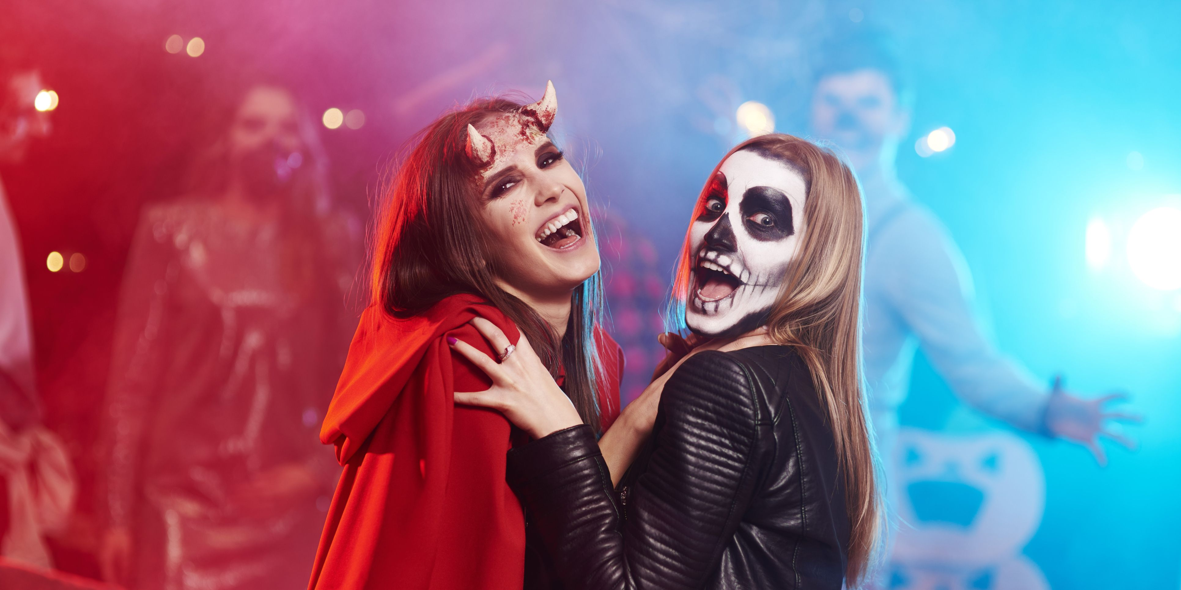 Women in creepy costumes dancing at Halloween party