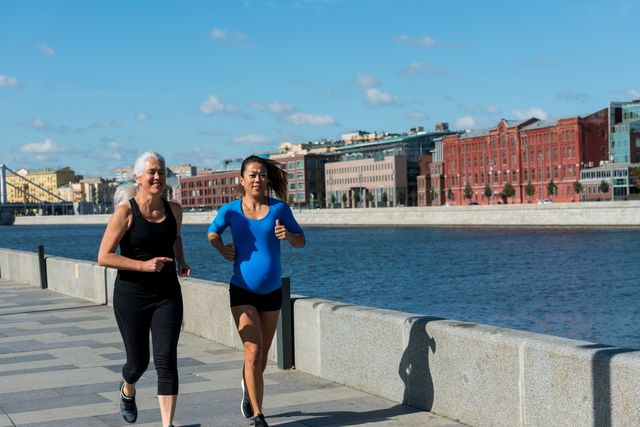 running while pregnant   women jog together