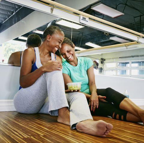 winter date ideas - Women laughing in yoga studio