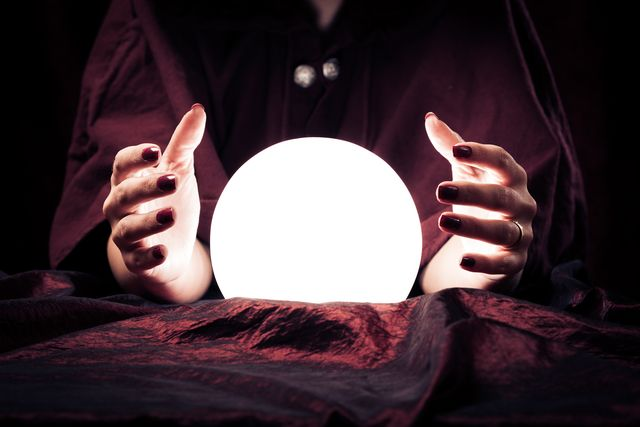 the scientific reason why women are more likely to believe in magic, ghosts, spirits etc shown here is a woman's hands at a crystal ball
