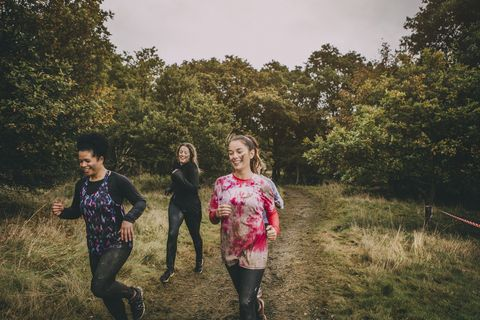 Women Running Through The Woods