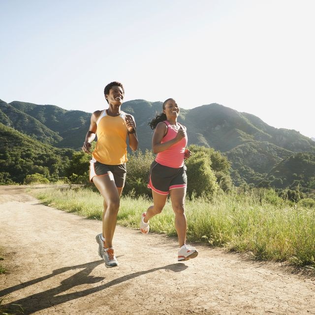 women running together on remote trail