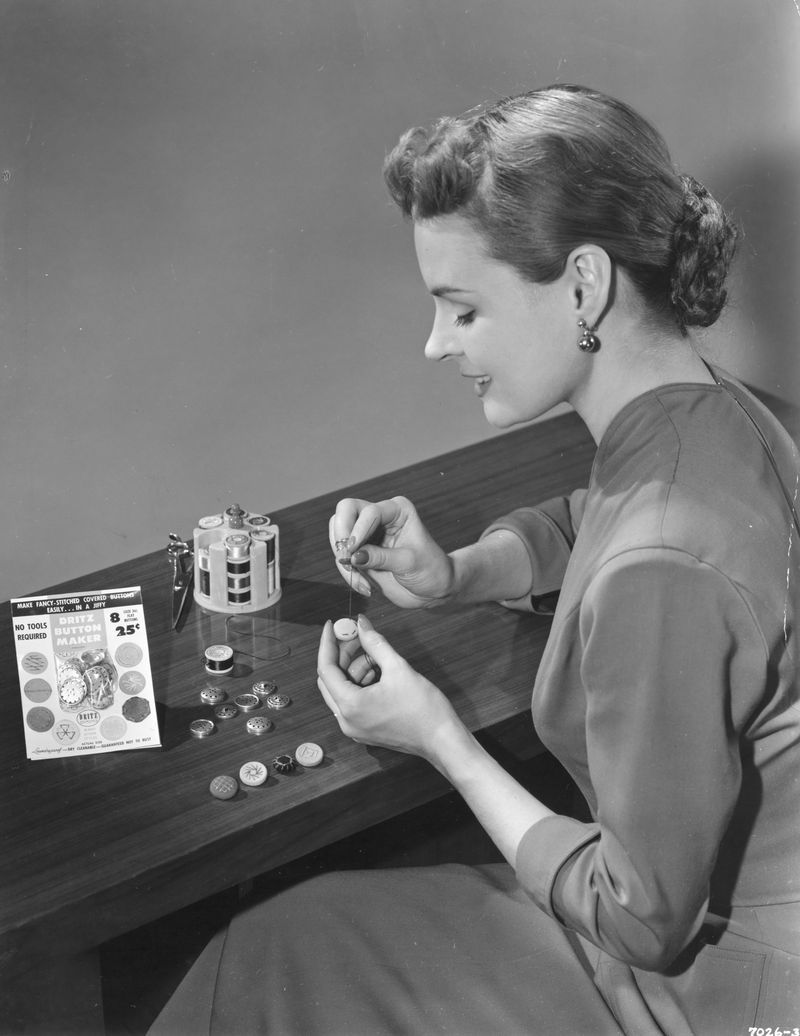 Woman Making Buttons with Kit