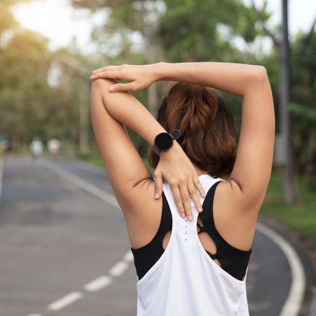 women stretching for warming up before running or working out young female runner stretching arms before running at morning fitness and healthy lifestyle concept