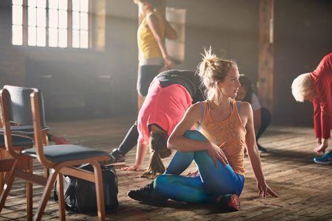 Women stretching in gym.