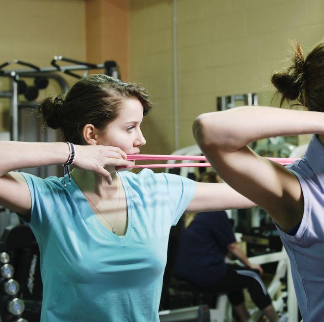 women using stretchers in gym