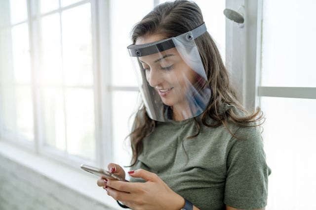 women wear mask and face shield to protect themselves