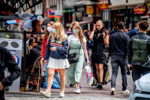 women wearing a face mask as a precaution against the spread