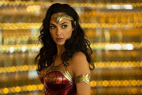 Beauty, Yellow, Black hair, Abdomen, Long hair, Trunk, Photography, Fictional character, Wonder Woman, Navel,