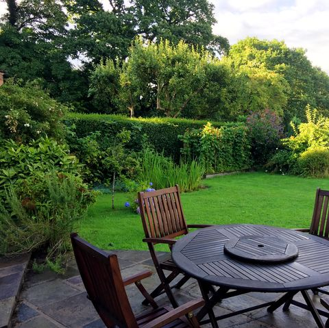 Wooden chairs and table in garden