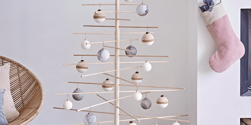9 Wooden Christmas Trees To Buy This Festive Season