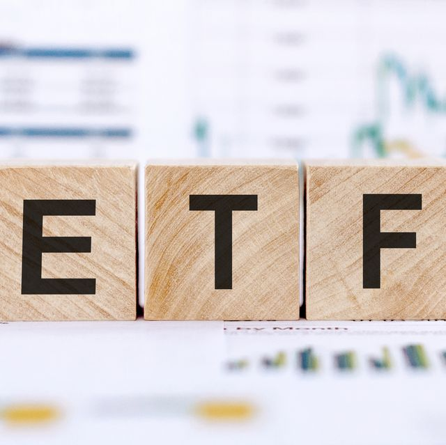 wooden text blocks of etf business and financial concept